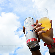 Music fans drink Budweiser during the 2016 Budweiser Made in America Festival Day 1 at Benjamin Franklin Parkway on September 3, 2016 in Philadelphia, Pennsylvania. (Photo by Lisa Lake/Getty Images for Anheuser-Busch)