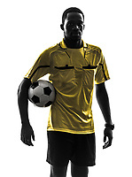 one african man referee standing holding football in silhouette on white background