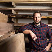 Josh Scheutzow, founder and owner of A Carpenter's Son poses for a portrait in their wood workshop in Sunbury, Ohio. (photo by Leonardo Carrizo)