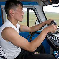 Enkhbold, driver for National Geographic photo team during 2006 archaeology expedition near Muren, Mongolia