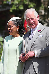 Doria Ragland and the Prince of Wales leave St George's Chapel in Windsor Castle following the wedding of Prince Harry and Meghan Markle.