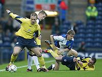 Photo. Aidan Ellis.<br /> Blackburn Rovers v Bolton Wanderers.<br /> FA Barclaycard Premiership.<br /> 10/01/2004.<br /> Blackburn's Paul Gallagher challenges Bolton's Kevin Nolan as Vratislav Gesko and Nicky Hunt tangle on the floor