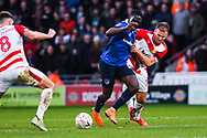 Christopher Missilou of Oldham Athletic (17) is fouled by Herbie Kane of Doncaster Rovers (15) during the The FA Cup fourth round match between Doncaster Rovers and Oldham Athletic at the Keepmoat Stadium, Doncaster, England on 26 January 2019.