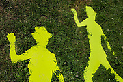 Glastonbury Festival, 2015.<br /> Green painted figures lying on the grass