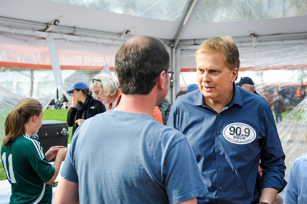 Tom Ashbrook greets attendees at the Boston Book Festival in Boston's Copley Square.