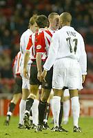 Photo. Andrew Unwin.<br /> Sunderland v Nottingham Forest, Nationwide League Division One, Stadium of Light, Sunderland 10/01/2004.<br /> Forest's Marlon King (r) squares up to Sunderland's Stephen Wright (c).