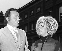 Elizabeth Taylor and Richard Burton leave Buckingham Palace.