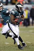 Philadelphia Eagles running back LeSean McCoy (25) takes a handoff during the NFL NFC Wild Card football game against the New Orleans Saints on Saturday, Jan. 4, 2014 in Philadelphia. The Saints won the game 26-24. ©Paul Anthony Spinelli