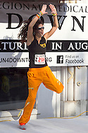Middletown, New York - An instructor from Studio Ayo leads a Zumba in the Street warmup before the 2012 Run 4 Downtown road race on Saturday, Aug. 18, 2012.