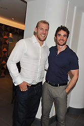 Left to right, JAMES HASKELL and THOM EVANS at the launch of famed American fitness club 'Equinox' 99 High Street Kensington, London on 23rd October 2012.