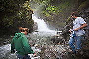 Alice and Dwight Bradley hike to the base of Thunderbird Falls in Chugach State Park near Anchorage, Alaska.