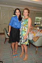 Left to right, YASMIN MILLS and AMBER NUTTALL  at a breakfast hosted by Halcyon Days at Fortnum & Mason, 181 Piccadilly, London on 8th July 2014.