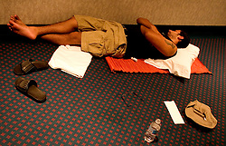 07 Sept 2005. New Orleans, Louisiana. Hurricane Katrina aftermath.<br /> <br /> Miami Herald's David Ovalle catches some sleep on the floor at the Hyatt from Hell in downtown New Orleans. Photo; ©Charlie Varley/varleypix.com