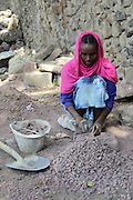 Africa, Ethiopia, Gondar woman crushes stones with hammer