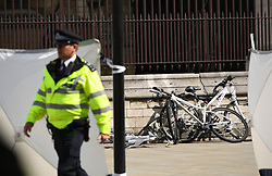 Bicycles on the pavement after a car crashed into security barriers outside the Houses of Parliament, Westminster, London.