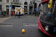 A London bus drives past a runaway yellow balloon floating along King William Street opposite Bank Underground station in the City of London, the capital's financial district, 7th March 2018, in London England.