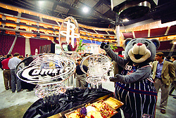 Stock photo of Clutch, the Houston Rockets mascot, posing with Houston sports ice sculptures