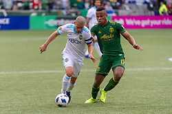 November 4, 2018 - Portland, OR, U.S. - PORTLAND, OR - NOVEMBER 04: Seattle Sounders midfielder Osvaldo Alonso (6) conducts the ball pressured by Portland Timbers Jeremy Ebobisse (17) during the Portland Timbers first leg of the MLS Western Conference Semifinals against the Seattle Sounders on November 04, 2018, at Providence Park in Portland, OR. (Photo by Diego Diaz/Icon Sportswire) (Credit Image: © Diego Diaz/Icon SMI via ZUMA Press)