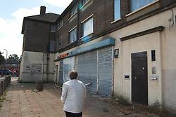 Boarded up housing & shops Brackenwood Council Estate; Huddersfield; Yorkshire; prior to redevelopment UK