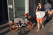 Mobike bike hire cycle with a traffic cone in the basket in London, England, United Kingdom.