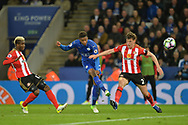 Demarai Gray of Leicester city takes a shot at goal as Billy Jones of Sunderland  tries ti block . Premier league match, Leicester City v Sunderland at the King Power Stadium in Leicester, Leicestershire on Tuesday 4th April 2017.<br /> pic by Bradley Collyer, Andrew Orchard sports photography.