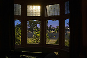 The frot bay window of an Edwardian-era home in a residential south London street in early evening, 7th August 2020, in Lambeth, London, England.