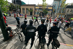 San Francisco police keep an eye on the proceedings at the 107th running of the Bay to Breakers, Sunday, May 20, 2018, in San Francisco. (Photo by D. Ross Cameron)