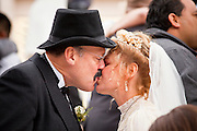 14 FEBRUARY 2012 - PHOENIX, AZ:    JIM OGSBURY and CHRISTINE COOK kiss during a mass wedding ceremony in Phoenix Tuesday. Ninetysix couples got married in a mass ceremony on the steps of the Arizona Supreme Court to mark the Valentine's Day holiday. The wedding was also an occasion to mark Arizona's centennial of statehood.   PHOTO BY JACK KURTZ
