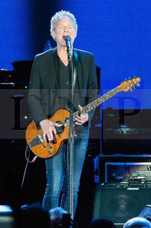 © Licensed to London News Pictures. 27/05/2015. London, UK.   Fleetwood Mac performing live at The O2 Arena, together with Christine Mc Vie who has rejoined the band.   In this picture - Lindsey Buckingham.  The band are due to headline the Isle of Wight Festival next month. Fleetwood Mac are a British-American rock band consisting of members Mick Fleetwood (drums), John McVie (bass guitar), Christine McVie (keyboards/vocals), Lindsey Buckingham (guitars, vocals), Stevie Nicks (vocals, tambourine).  Photo credit : Richard Isaac/LNP