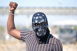 RUSTENBURG SOUTH AFRICA - MAY 18: A protester poses wearing a skull mask on May 18, 2020. in Rustenburg, South Africa. Seraleng residents gathered Sibanye k5 mine shaft Communities in the area alleged complaints of food parcel corruption by a local ward councillor. Grievances also included concerns with unemployment, loss of business and access to a social labour plan. (Photo by Gallo Images/Dino Lloyd)