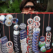 A street vendor sells Mitt Romney and Republican Party pins during the Republican National Convention in Tampa, Fla. on Wednesday, August 29, 2012. (AP Photo/Alex Menendez)