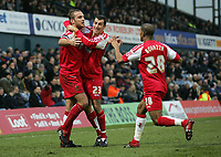 Photo: Paul Thomas.<br /> Oldham Athletic v Swindon Town. Coca Cola League 1.<br /> 10/12/2005.<br /> <br /> Sean O'Hanlon is congratulated by team mates Hameur Bouazza and Neale McDermott after scoring for Swindon.