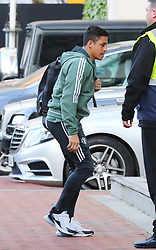 The Manchester United team arrive at The Lowry Hotel on Saturday evening to prepare for their home game against West Brom on Sunday afternoon. Seen: Alexis Sanchez.
