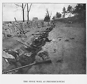 Behind the deadly stone wall of Marye s Heights after Sedgwick s men had swept across it in the gallant charge of May 3, 1863. This was one of the strongest natural positions stormed during the war. In front of this wall the previous year, nearly 6,000 of Burnside s men had fallen, and it was not carried. Again in the Chancellors ville campaign Sedgwick s Sixth Corps was ordered to assault it. It was defended the second time with the same death-dealing stubbornness but with less than a fourth of the former numbers 9,000 Confederates against 20,000 Federals. At eleven o clock in the morning the line of battle, under Colonel Hiram Burnham, moved out over the awful field of the year before, supported to right and left by flanking columns. Up to within twenty-five yards of the wall they pressed, when again the flame of musketry fire belched forth, laying low in six minutes 36.5 per cent, of the Fifth Wisconsin and the Sixth Maine. The assailants wavered and rallied, and then with one impulse both columns and line of battle hurled themselves upon the wall in a fierce hand-to-hand combat. from the book ' The Civil war through the camera ' hundreds of vivid photographs actually taken in Civil war times, sixteen reproductions in color of famous war paintings. The new text history by Henry W. Elson. A. complete illustrated history of the Civil war