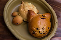 Bread and Baked Goods Characters -  Bentos or kyaraben are elaborately decorated and arranged Japanese lunch boxes. To amuse children, the characters come from popular TV shows, movies, animation favorites, and cute animals. The thinking behind them is this: decorating a child's lunch makes the kid interested in a variety of food and to encourage a wider range of eating habits.   Kids at school admire each others lunches, and gain a kind of status with the coolest lunch boxes, causing rivalry among both kids and mothers.  This has evolved to the point where national contests are held now for best lunch boxes, judged on design and nutritional values.  Even cook books are being published on the subject.  Some of these bentos are truly works of art, with great attention to detail.  Others kind of resemble a dogs dinner.