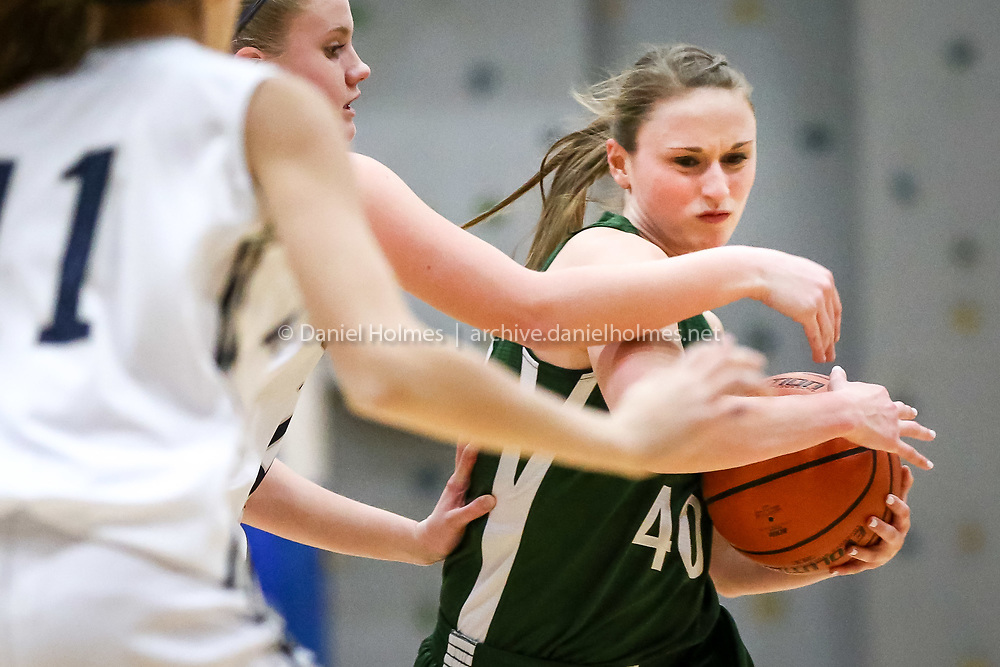 (2/11/16, MEDWAY, MA) Westwood's Cailin Harrington pushes through the defense during the girls basketball game against Medway at Medway High School on Thursday. Daily News and Wicked Local Photo/Dan Holmes