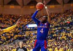 Feb 12, 2020; Morgantown, West Virginia, USA; Kansas Jayhawks guard Isaiah Moss (4) shoots a three pointer during the first half against the West Virginia Mountaineers at WVU Coliseum. Mandatory Credit: Ben Queen-USA TODAY Sports
