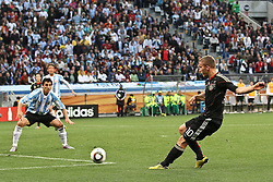 03.07.2010, CAPE TOWN, SOUTH AFRICA, Lukas Podolski of Germany as a shot at a goal as Nicolas Burdisso of Argentina looks on  during the Quarter Final, Match 59 of the 2010 FIFA World Cup, Argentina vs Germany held at the Cape Town Stadium EXPA Pictures © 2010, PhotoCredit: EXPA/ nph/  Kokenge