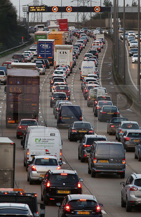 © Licensed to London News Pictures. 23/12/2015. London, UK. Traffic queues fill all four lanes north bound on the M25 near West Byfleet as the Christmas getaway starts.  Photo credit: Peter Macdiarmid/LNP