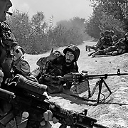 """Jul 11, 2008 - Zhari District, Kandahar Province, Afghanistan -  Under fire a frightened and stunned Afghan machine gunner asks a Canadian Soldier how they could defeat the Taliban after a long and heavy fire fight near """"Contact Corner"""" by """"Taliban Road"""" in the Spin Pir area of Zhari District, Afghanistan. This area is located within several km of what is believed to be the birthplace of the Taliban lead by Mullah Omar..(Credit Image: © Louie Palu/ZUMA Press)"""