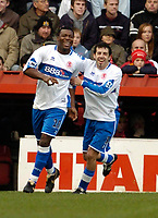 Photo: Leigh Quinnell.<br /> Bristol City v Middlesbrough. The FA Cup. 27/01/2007.<br /> Boros' Julio Arca(R) congratulates Yakubu on his goal.