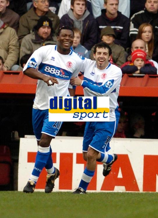 Photo: Leigh Quinnell.<br /> Bristol City v Middlesbrough. The FA Cup. 27/01/2007.<br /> Boros' Julio Arca(R) congratulates Yakubu on his goal.