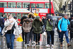 © Licensed to London News Pictures. 15/02/2020. London, UK. Members of public struggle to walk in Trafalgar Square during wet and windy weather as Storm Dennis arrives in London. Heavy rain and strong winds are forecast from today until Monday 17 February as the Storm Dennis sweeps across the UK with heavy rain, gale force winds and flooding. Photo credit: Dinendra Haria/LNP