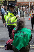 A Quaker environmental activist from Exeter is arrested while protest about Climate Change during the blockade of Whitehall in central London, part of a two-week prolonged worldwide protest by members of Extinction Rebellion, on 16th October 2019, in Westminster, London, England.