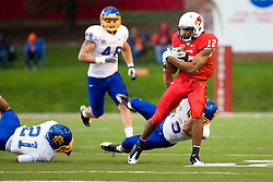 24 September 2011: Tyrone Walker looks for room to run with David Godley and Bo Helm in pursuit during an NCAA football game between the South Dakota State Jackrabbits (SDSU) and the Illinois State Redbirds (ISU) at Hancock Stadium in Normal Illinois.