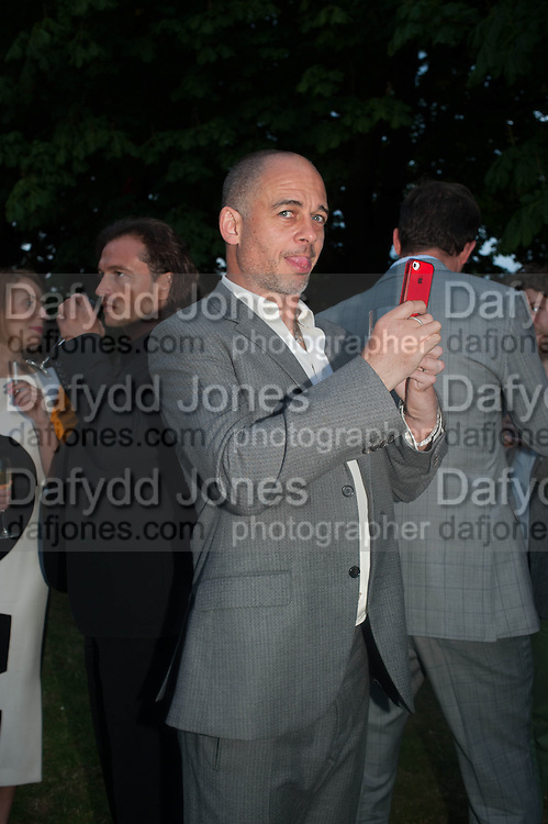 DINOS CHAPMAN, The Serpentine Summer Party 2013 hosted by Julia Peyton-Jones and L'Wren Scott.  Pavion designed by Japanese architect Sou Fujimoto. Serpentine Gallery. 26 June 2013. ,
