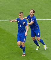 GOAL CELEBRATION - Croatia's Ivan Perisic celebrates scoring the opening goal with Ivan Rakitic (right)<br /> <br /> Photographer Craig Mercer/CameraSport<br /> <br /> International Football - 2016 UEFA European Championship - Group D, Czech Republic v Croatia - Stade Geoffroy Guichard, St Etienne - France <br /> <br /> World Copyright © 2016 CameraSport. All rights reserved. 43 Linden Ave. Countesthorpe. Leicester. England. LE8 5PG - Tel: +44 (0) 116 277 4147 - admin@camerasport.com - www.camerasport.com