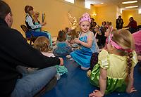 "Cousins Briella Prescott and Audbrey Prescott are ""princesses"" for a day at the Anna and Elsa Tea Party at Gilford Community Center Saturday morning.  (Karen Bobotas/for the Laconia Daily Sun)"