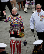 The Danish Queen Margereth and Prince Consort Henrik outside Cathedral Annaassisitta Oqaluffia,  Nuuk on Greenland's National Day, wearing traditional Inuit clothing. .From June 21 2009, Greenland moves from being under 'home rule' to 'self-governance' in a ceremony attended by the Danish Royal family and other heads of state.
