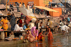 Hindus gather and wash along India's Ganges River in their holiest city, Varanasi (formerly Banaras). Varanasi is principally known to travelers for its ghats (stone steps leading directly into the water). Most ghats are used for ritual bathing. Hindu pilgrims, while standing waist high in the water, pray to cleanse their souls as they face the rising sun.Varanasi also has cremation ghats because Hindus believe that those who die and are cremated in Varanasi go directly to heaven, bypassing the lengthy reincarnation process. First the dead are burned on riverside pyres, then their ashes are scattered on the sacred Ganges River.